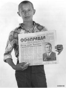 Boy holding Pravda